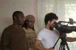Director Storm frames the shot as Raymond Lawson and Ezra Tomlinson look on